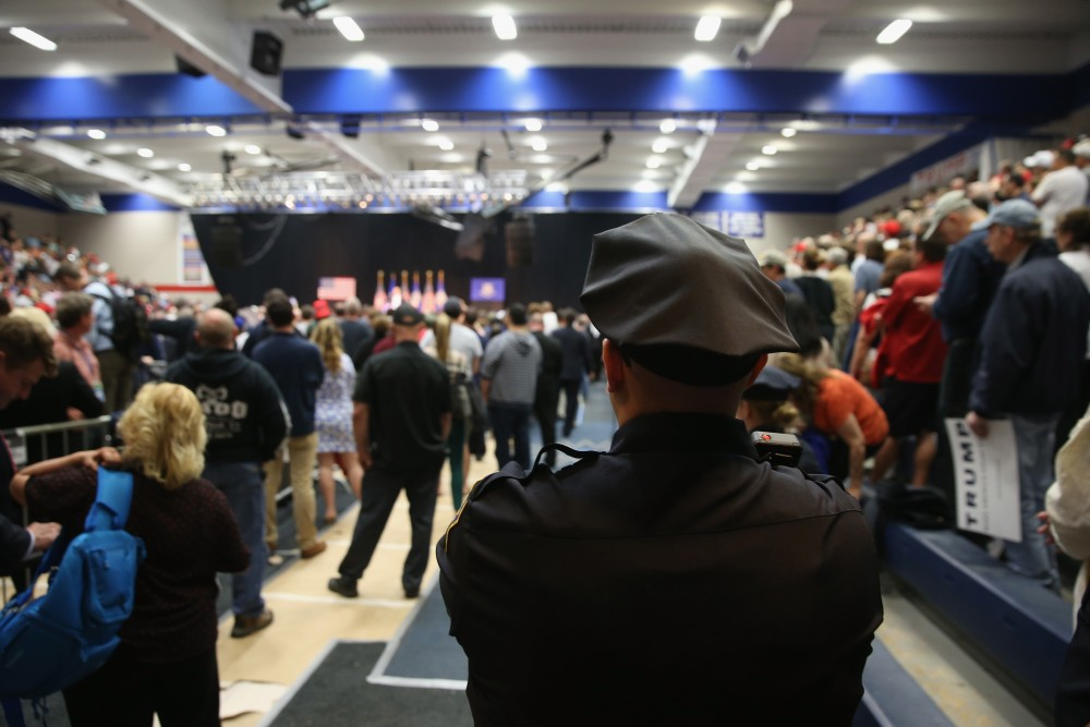WATERBURY, CT - APRIL 23:  A policeman watches as as Republican Presidential frontrunner Donald Trump speaks at a campaign rally on April 23, 2016 in Waterbury, Connecticut. Supporters packed the Crosby High School gym to hear Trump's address ahead of Tuesday's Connecticut primary election.  (Photo by John Moore/Getty Images)