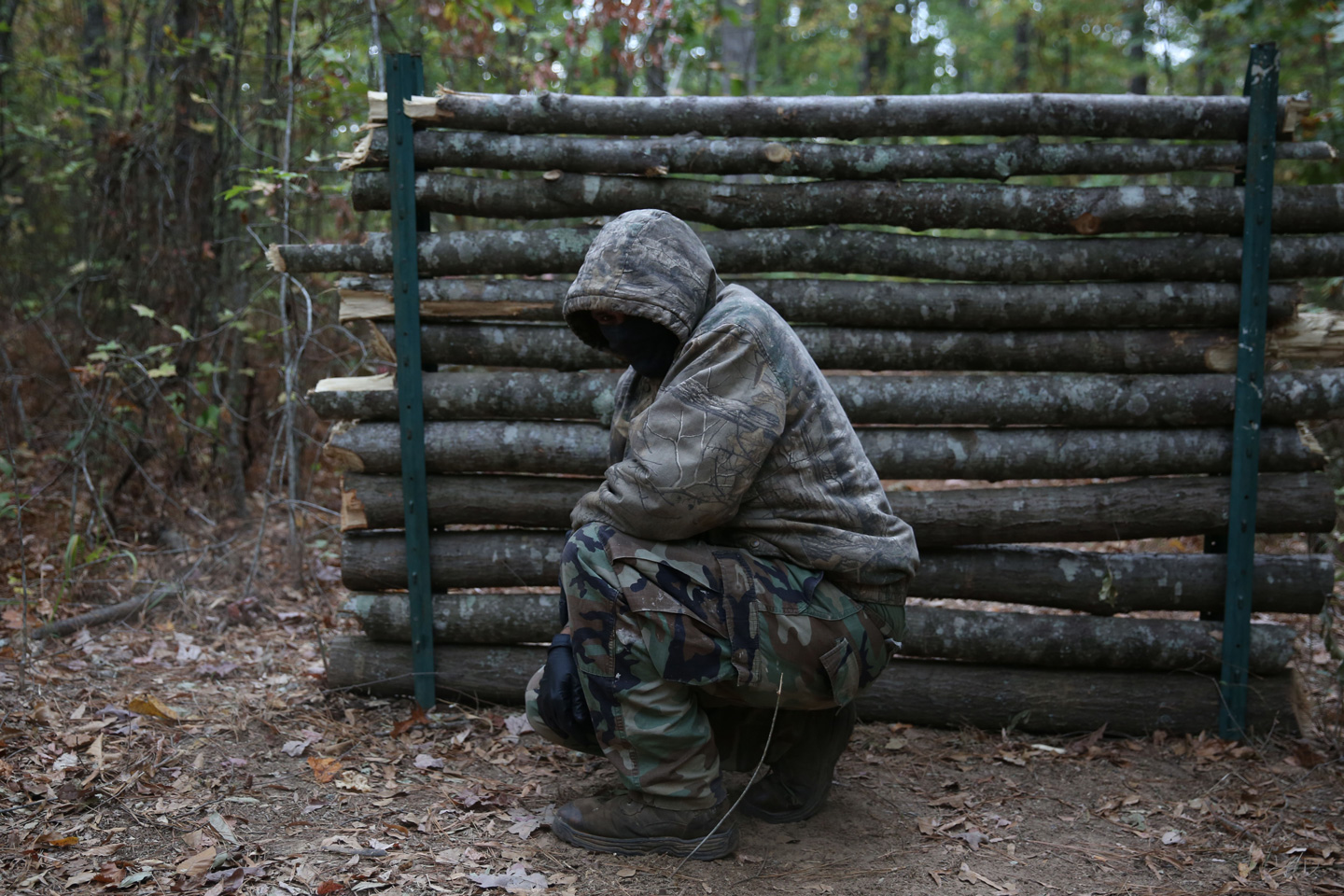 """FLOVILLA, UNITED STATES - NOVEMBER 12: A member of the Georgia Security Forces (GSF) is seen during military drill with group members of III% Georgia Security Force in Flovilla, Georgia, USA on November 12, 2016. The militia calls itself the Georgia Security Forces (GSF), they are white supremacists on the look for foreign threats either it's the Russians or ISIS as they claim. The group is a part of a wider unlinked phenomena called """"The Three Percenters (III%)"""" who are scattered across the US and claim to be the only noble Americans who've fought against the British during the revolution. (Photo by Mohammed Elshamy/Anadolu Agency/Getty Images)"""