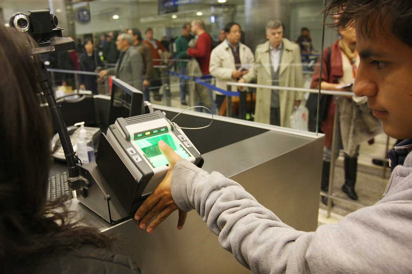 LOS ANGELES, CA - DECEMBER 10:  International air travelers are electronically fingerprinted as they are processed by US Customs and Border Protection agents upon arrival to Bradley International Terminal at Los Angeles International Airport (LAX), on December 10, 2009 in Los Angeles, California. December is the busiest time of the year for international travel and the US CBS is trying to educate the public on ways to get through the customs process efficiently.  (Photo by David McNew/Getty Images)