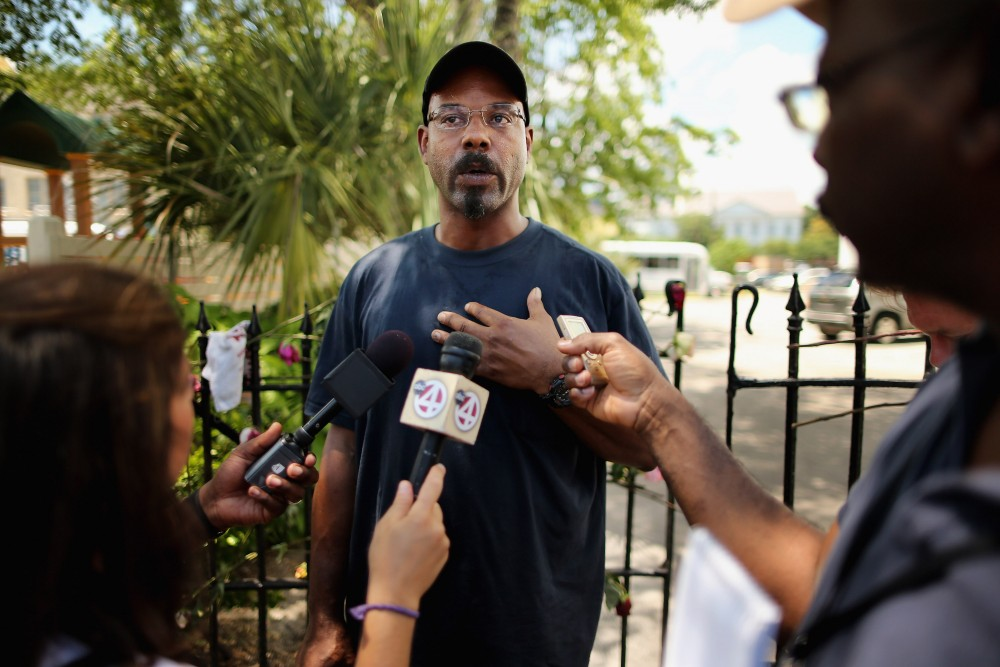 CHARLESTON, SC - JUNE 20:  Arthur Hurd (C) tells the story of the first time he saw his wife, librarian Cynthia Hurd, while talking to reporters outside the historic Emanuel African Methodist Church where she and eight others were shot to death June 20, 2015 in Charleston, South Carolina. Hurd is a merchant marine and was in the Persian Gulf when his wife was killed and returned to Charleston Saturday. Members of the church announced that services and Sunday school will go ahead as scheduled tomorrow, four days after the murder of nine churchgoers. Suspect Dylann Storm Roof, 21, was captured and charged in their deaths.  (Photo by Chip Somodevilla/Getty Images)