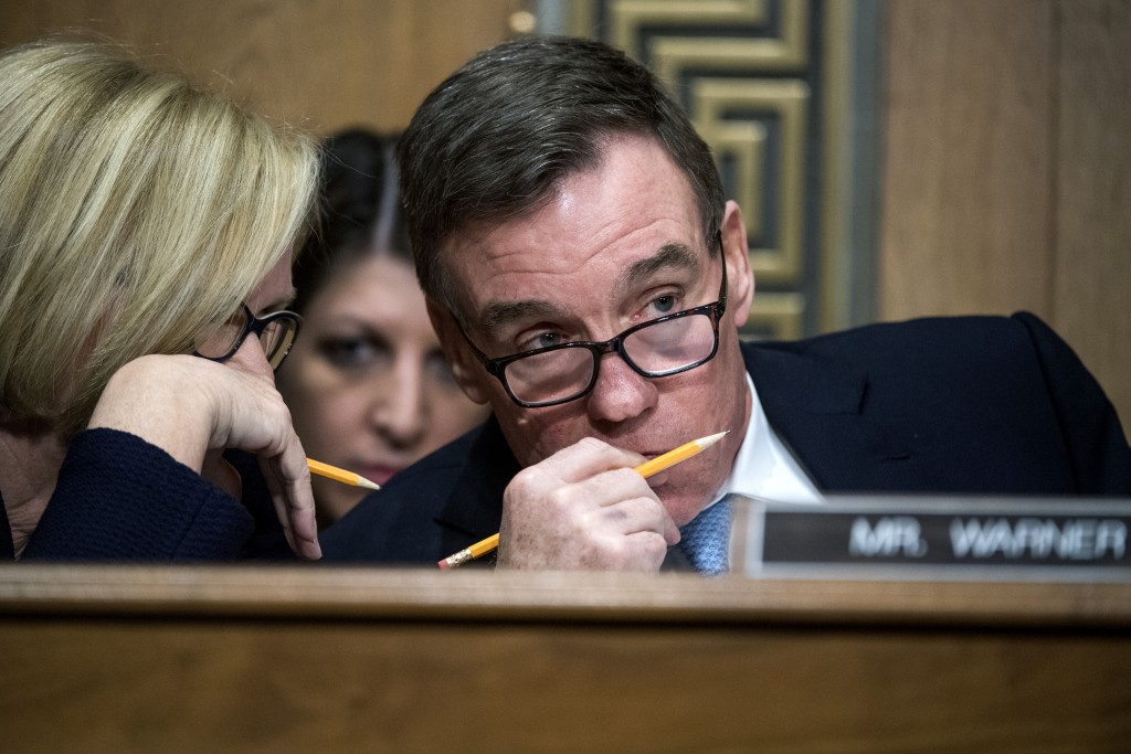 UNITED STATES - JANUARY 19: Sens. Claire McCaskill, D-Mo., and Mark Warner, D-Va., confer during the Senate Finance Committee confirmation hearing for Steven Mnuchin, President-elect Trump's nominee for Treasury secretary, in Dirksen Building, January 19, 2017. (Photo By Tom Williams/CQ Roll Call)  (CQ Roll Call via AP Images)