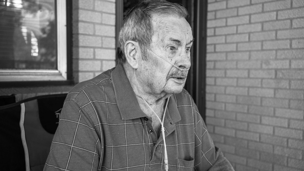 Clifford Bickel sits in front of his house. He rarely travels anywhere because he requires an oxygen tank to breathe after smoking cigarettes for much of his life. Wellington, KS. July 17, 2017.