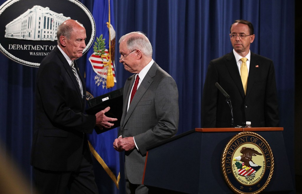 """WASHINGTON, DC - AUGUST 04:  (L-R) U.S. Director of National Intelligence Dan Coats, Attorney General Jeff Sessions, and Deputy Attorney General Rod Rosenstein attend an event at the Justice Department August 4, 2017 in Washington, DC. Sessions held the event to discuss """"leaks of classified material threatening national security.""""  (Photo by Alex Wong/Getty Images)"""
