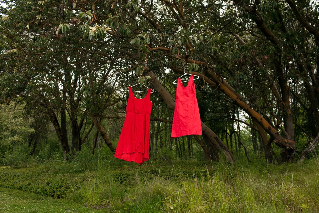 Two red dresses hang in a tree at Swan Creek Park on Friday, May 11, 2018, in Tacoma, Wash. The red dresses symbolize murdered and missing indigenous women. Carolyn DeFord's mother, Leona LeClair Kinsey, a member of the Puyallup Tribe, disappeared 18 years ago. As time went on after her mother's disappearance, DeFord began reaching out to other women whose family members had gone missing. She started a Facebook page with their faces and the details of their cases. (Jovelle Tamayo for The Intercept)