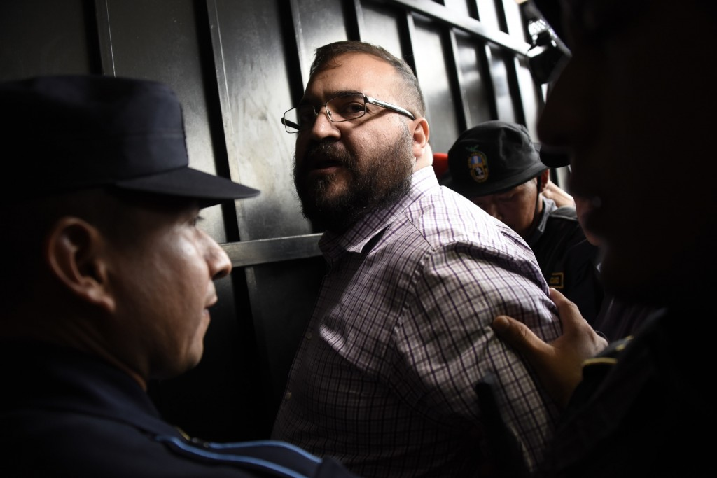 Javier Duarte, former governor of the Mexican state of Veracruz, accused of graft and involvement in organized crime, is escorted by police officers for a hearing to decide on his extradition, at the Supreme Court in Guatemala City on June 27, 2017.&lt;br /&gt;&lt;br /&gt;&lt;br /&gt;&lt;br /&gt;&lt;br /&gt;&lt;br /&gt;&lt;br /&gt;&lt;br /&gt;<br /> Duarte, suspected of embezzling hundreds of millions of dollars, was arrested on April 15 in Guatemala after six months on the run with Mexico filing its extradition request later that night. / AFP PHOTO / Johan ORDONEZ        (Photo credit should read JOHAN ORDONEZ/AFP/Getty Images)