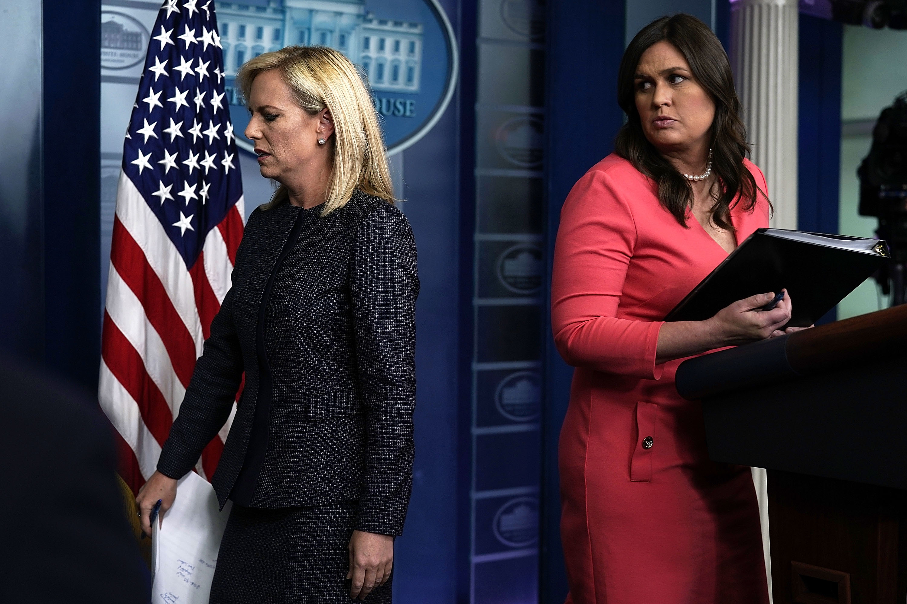 U.S. Secretary of Homeland Security Kirstjen Nielsen (L) leaves after she briefed members of the press as White House Press Secretary Sarah Sanders (R) looks on during a White House daily news briefing at the James Brady Press Briefing Room of the White House June 18, 2018 in Washington, DC. Nielsen joined White House Press Secretary Sarah Sanders at the daily news briefing to answer questions from members of the White House Press Corps.   (Photo by Alex Wong/Getty Images)