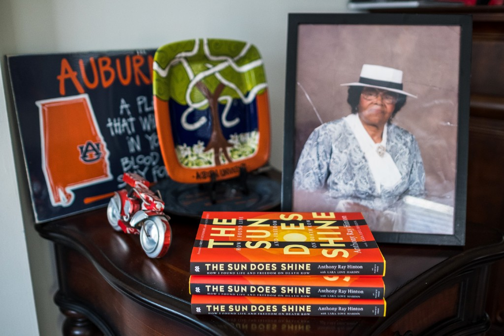 """Anthony Ray Hinton recently released his memoir, &quot;The Sun Does Shine: How I Found Life and Freedom on Death Row."""" A photo of his mother sits next to his books on a side table in his home in Quinton, Alabama, Sunday, June 3, 2018. Hinton spent 30 years on death row after he was wrongfully incarcerated for two murders he did not commit.&lt;br /&gt;&lt;br /&gt;&lt;br /&gt;&lt;br /&gt;&lt;br /&gt;<br /></a></div><div class="""