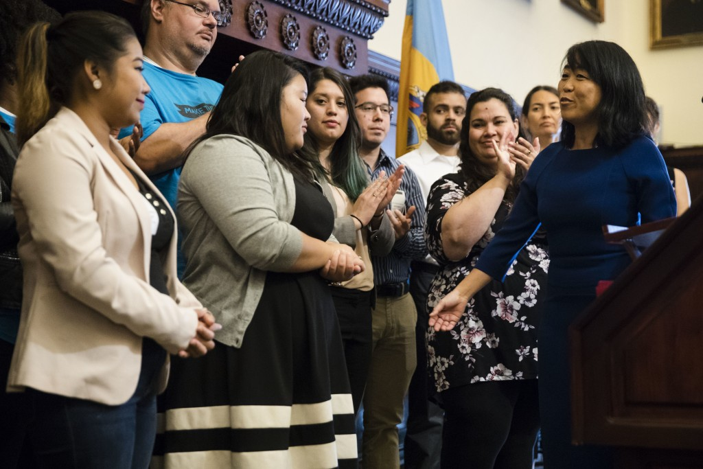 City Councilwoman Helen Gym, right, accompanied by Deferred Action for Childhood Arrivals program recipients, and activists, speaks during a news conference in Philadelphia, Monday, Sept. 11, 2017. Politicians and organizations in Philadelphia are raising money to help pay for applications to a soon-to be-ended program that allows young immigrants without legal status to remain in the country. (AP Photo/Matt Rourke)