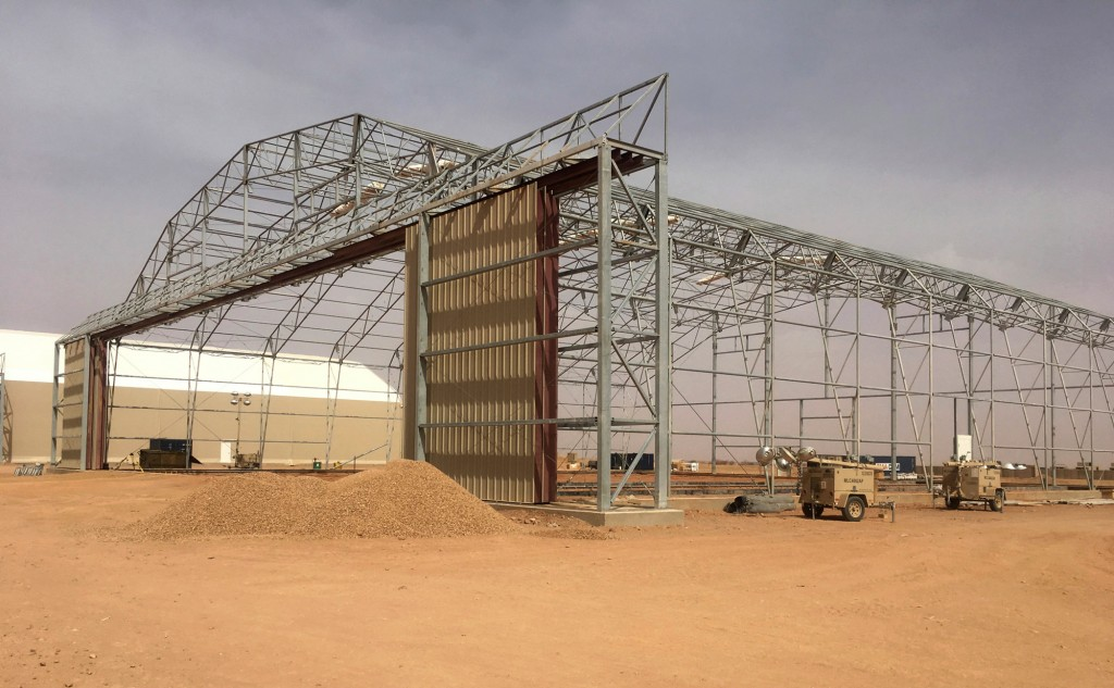 In this photo taken Sunday, April 15, 2018, a Hangar being built at the Niger Air Base 201 Agadez, Niger. On the scorching edge of the Sahara Desert, the U.S. Air Force is building a base for armed drones, the newest front in America's battle against the growing extremist threat in Africa's vast Sahel region. Three hangars and the first layers of a runway command a sandy, barren field. Niger Air Base 201 is expected to be functional early next year. (AP Photo/Carley Petesch)