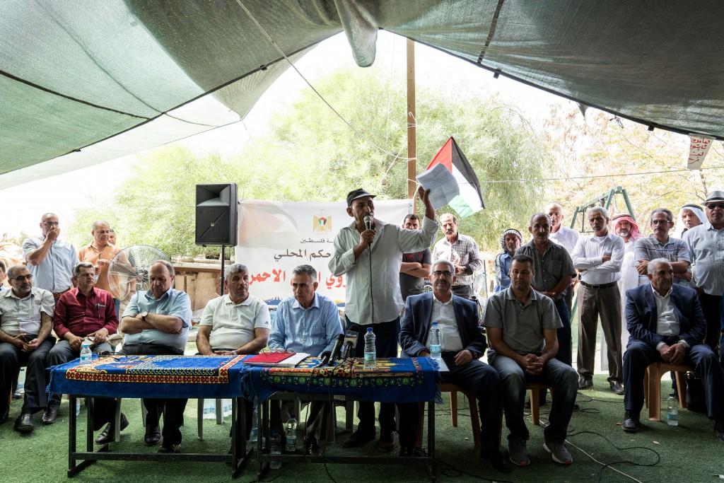 Abu Khamees (C) speaks during a press conference at the Al-Khan Al-Ahmar village on July 26, 2018.