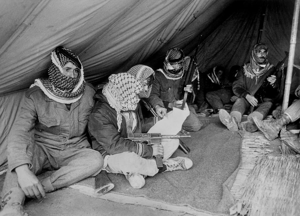 BAQUAR, JORDAN:  Fatah militiamen rest under a tent close to the Jordan river in Jordan 04 November 1969. After Israeli army started a lightning war in Syria, Sinan and Jordan in June 1967 the problem of Palestinian refugees increased without precedent in the Arab countries around Israel. Des militants du Fatah se reposent sous une tente prFs de la rive jordanienne du Jourdain le 04 novembre 1969. A la suite de la guerre-Tclair lancTe par l'armTe israTlienne en Syrie, dans le Sinan et en Jordanie en juin 1967, le problFme des rTfugiTs palestiniens a pris une ampleur sans prTcTdent dans les pays arabes entourant Isradl. (Photo credit should read AFP/AFP/Getty Images)