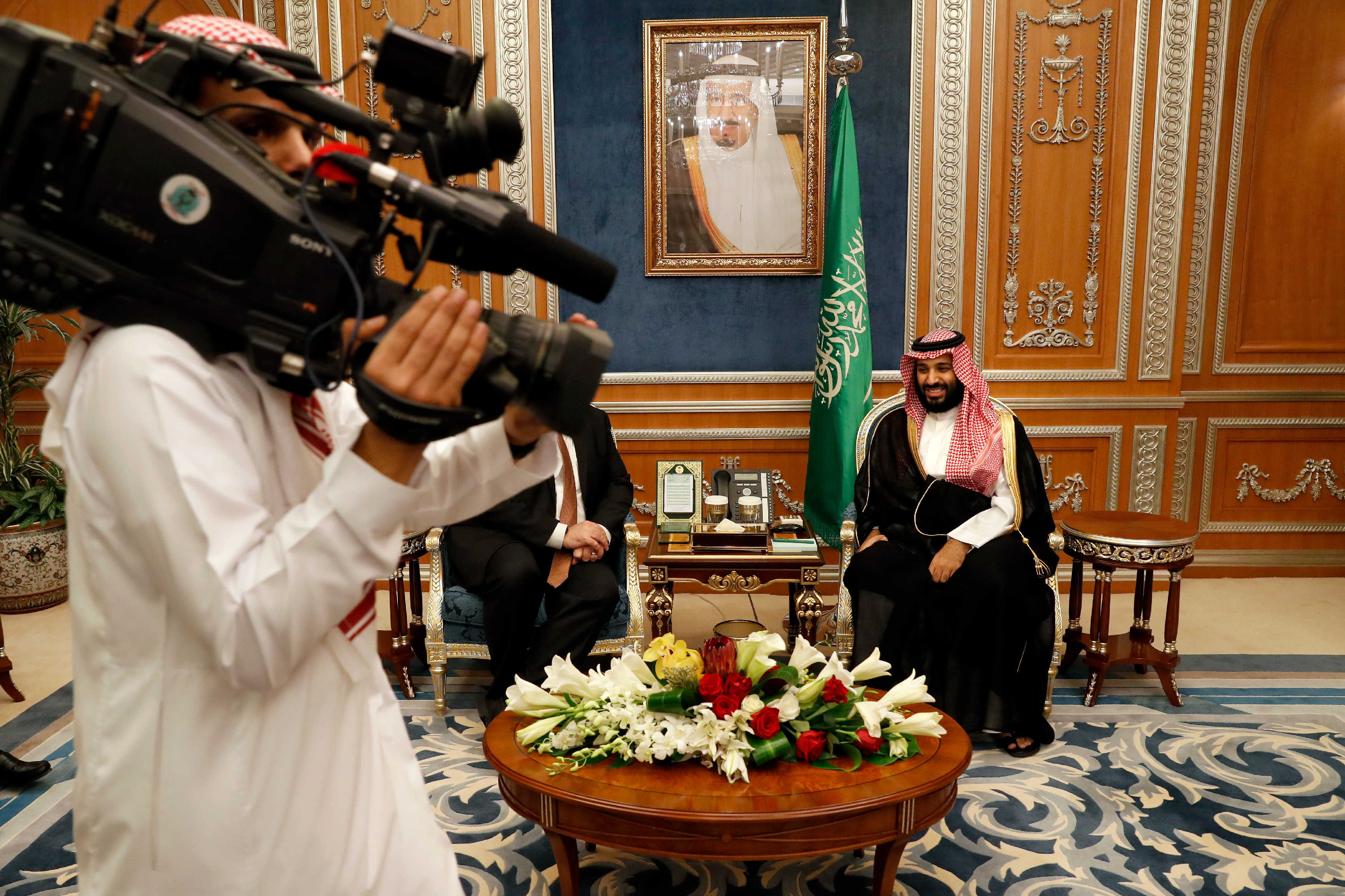 A cameraman gets into position as U.S. Secretary of State Mike Pompeo meets with Saudi Crown Prince Mohammed bin Salman, in Riyadh, Saudi Arabia, Tuesday Oct. 16, 2018. Pompeo also met on Tuesday with Saudi King Salman over the disappearance and alleged slaying of Saudi writer Jamal Khashoggi, who vanished two weeks ago during a visit to the Saudi Consulate in Istanbul. (Leah Millis/Pool via AP)