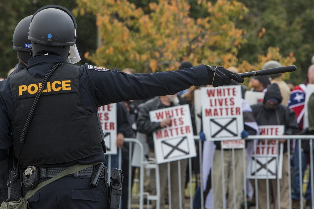 """Police stand between protestors during a White Lives Matter rally on October 28, 2017 in Shelbyville, Tennessee. Tennessee Gov. Bill Haslam said state and local law enforcement officials would be out """"in full force"""" for the two white nationalist rallies. The event billed as a White Lives Matter rally is hosted by Nationalist Front, which is a coalition of several white supremacist organizations. (Photo by Joe Buglewicz/Getty Images)"""
