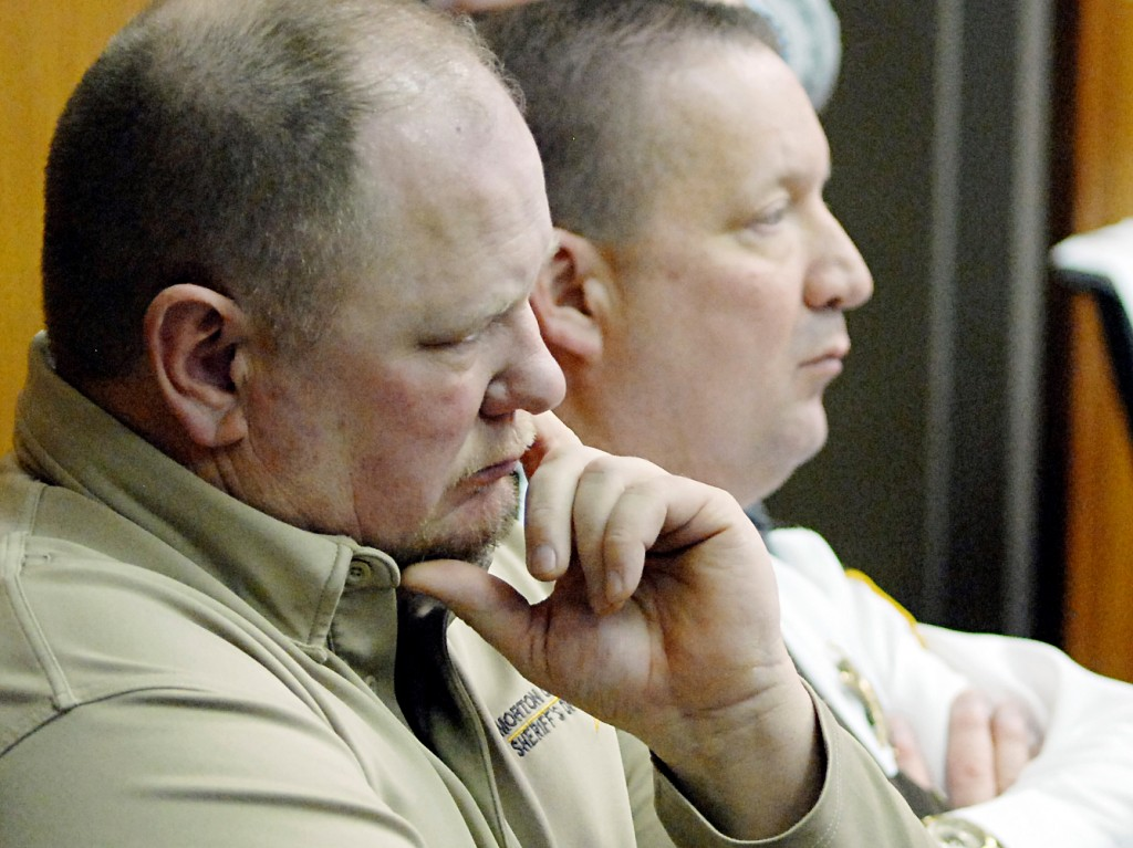 Morton County (ND) Sheriff Kyle Kirchmeier, left, and Cass County (ND) Sheriff Paul Laney attend a pretrial conference for defendant Chase Iron Eyes at the Morton County Courthouse on Wednesday, April 4, 2018, in Mandan, N. D. Iron Eyes is charged with felony inciting a riot and misdemeanor criminal trespass related to the Dakota Access Pipeline protests on Feb. 1, 2017. (Mike McCleary /The Bismarck Tribune via AP)
