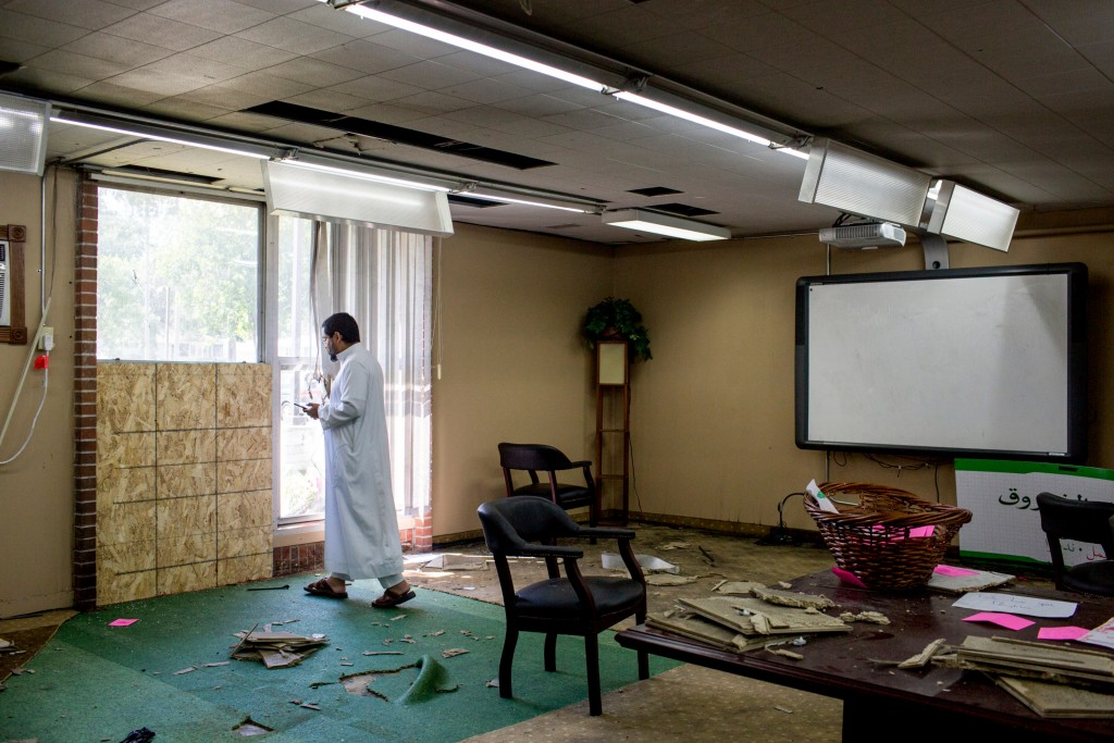 FILE - In this Aug. 7, 2017, file photo, Asad Zaman stands at the site of the bombing in the Dar Al Farooq Islamic Center in Bloomington, Minn. Michael Hari pleaded not guilty, Thursday, Feb. 14, 2019, in federal court in St. Paul, Minn., in the bombing of the Minnesota mosque, three weeks after two of his alleged accomplices pleaded guilty. Federal prosecutors allege Hari was the ringleader of an Illinois-based militia and that the trio drove more than 500 miles to bomb the mosque in hopes of scaring Muslims into leaving the U.S. No one was injured in the August 2017 attack. (Courtney Pedroza/Star Tribune via AP)