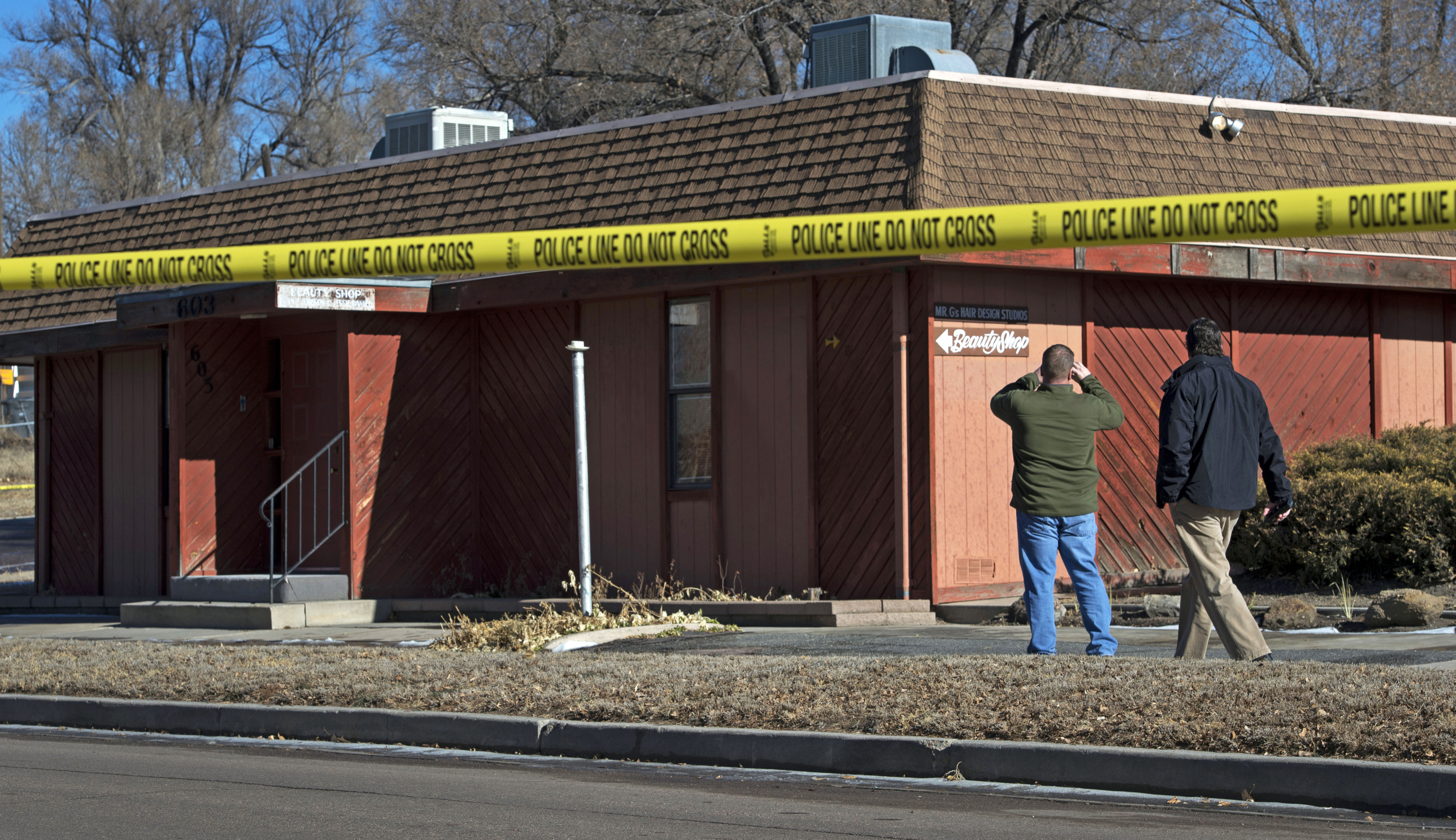 FILE - In this Jan. 6, 2015 file photo, Colorado Springs, Colo., police officers investigate the scene of an explosion at a building in Colorado Springs that houses a barber shop and the Colorado Springs chapter of the NAACP. (AP Photo/The Colorado Springs Gazette, Christian Murdock, File