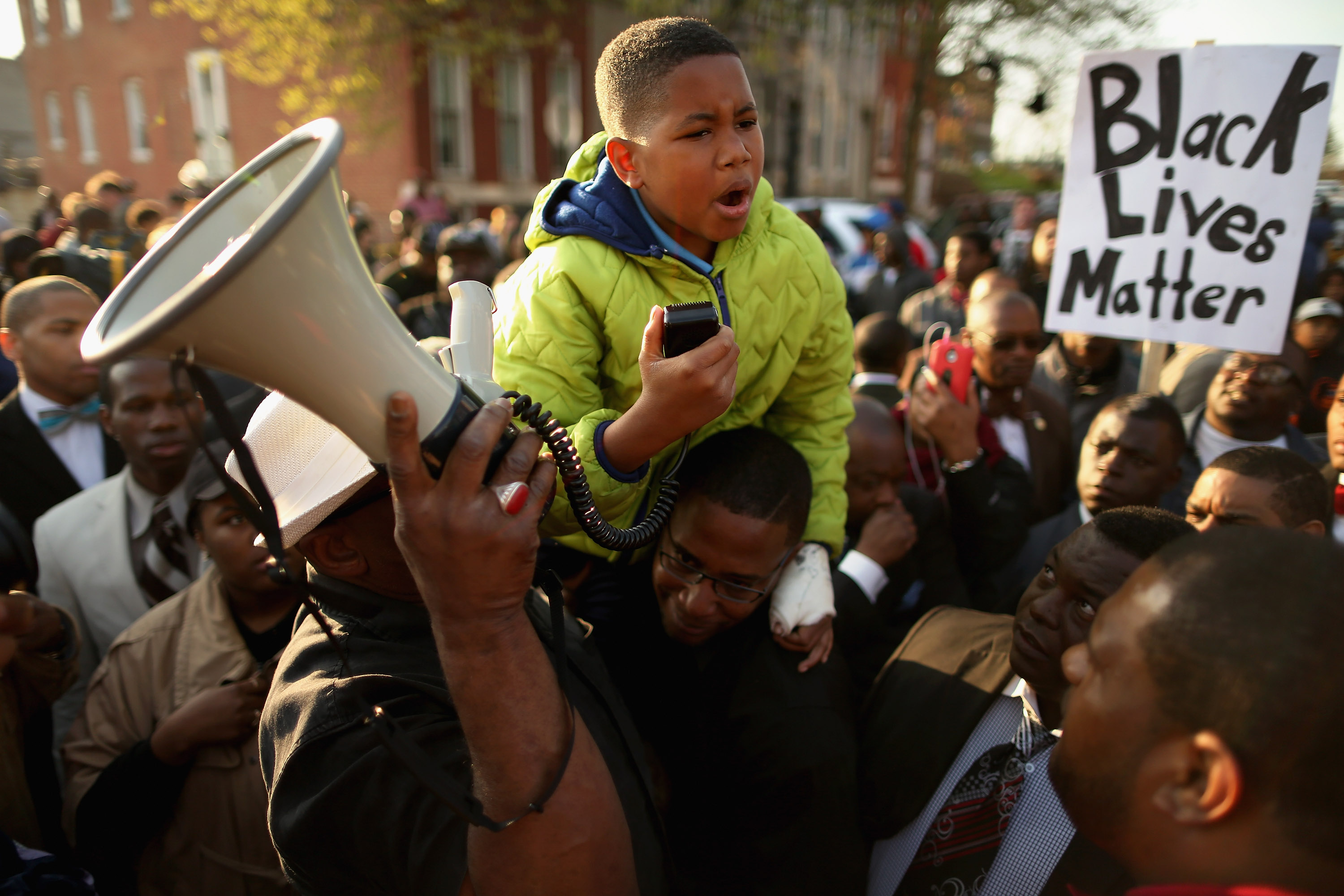 BALTIMORE, MD - APRIL 22:  Ten-year-old Robert Dunn uses a megaphone to address hundreds of demonstrators during a protest against police brutality and the death of Freddie Gray outside the Baltimore Police Western District station April 22, 2015 in Baltimore, Maryland. Gray, 25, was arrested for possessing a switch blade knife April 12 outside the Gilmor Homes housing project on Baltimore's west side. According to his attorney, Gray died a week later in the hospital from a severe spinal cord injury he received while in police custody.  (Photo by Chip Somodevilla/Getty Images)