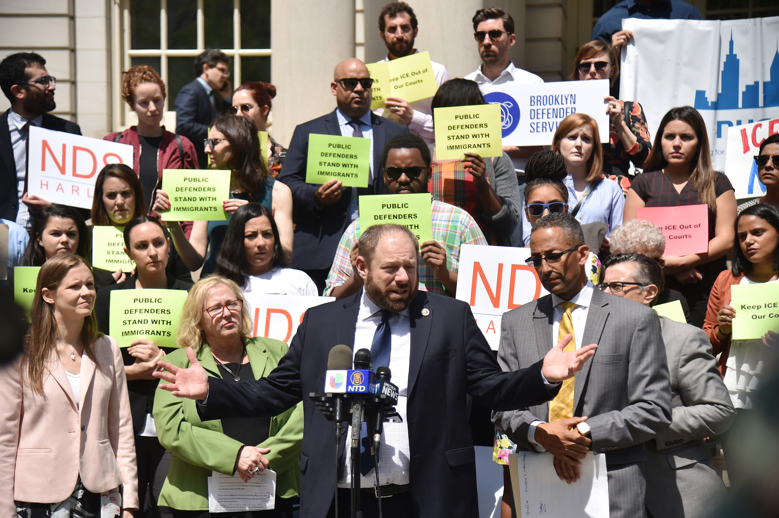 New York City council member Rory Lancman surounded by public defenders and advocates give a press conference to demand to the Chief judge DiFiore to prohibit ICE arrests in all courthouses, except when authorized by a judicial warrant, in New York, on May 9, 2018. (Photo by HECTOR RETAMAL / AFP)(Photo credit should read HECTOR RETAMAL/AFP/Getty Images)