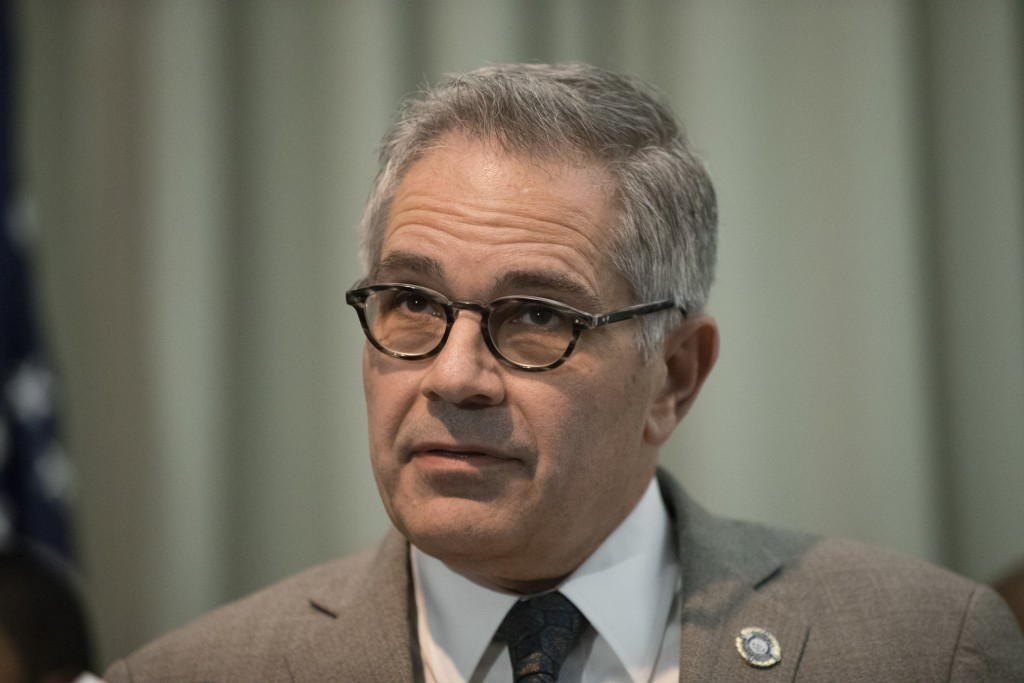 FILE - In this Dec. 19, 2018 file photo, Philadelphia District Attorney Larry Krasner speaks with members of the media during a news conference in Philadelphia. Krasner, Philadelphia's top prosecutor, will fight a decision that gives former Black Panther Mumia Abu-Jamal a new appeals hearing in a 1981 police slaying. Krasner says in a filing Friday that he'll challenge an order that would revive the high-profile case. The 64-year-old activist is serving life without parole after his death sentence was thrown out over flawed jury instructions. (AP Photo/Matt Rourke, file)
