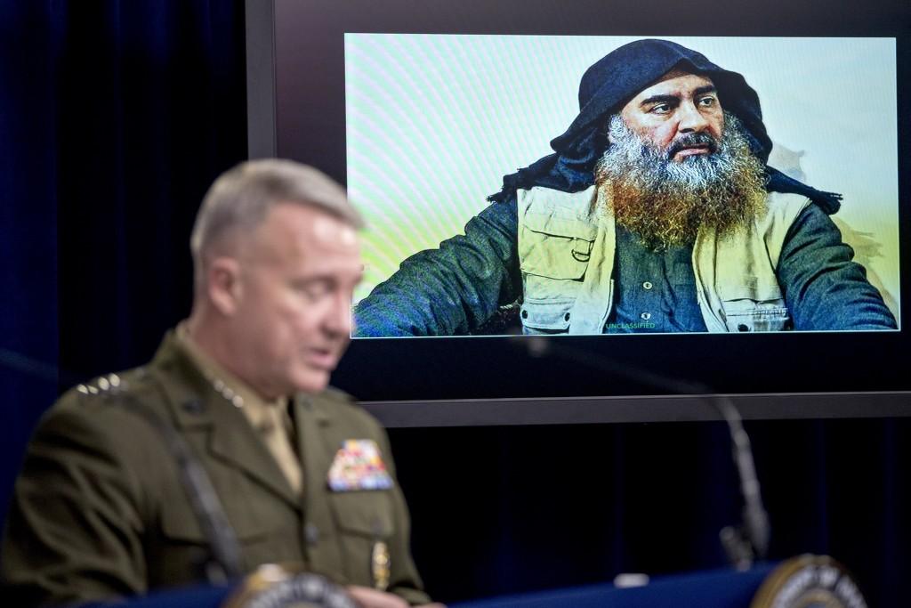 Abu Bakr al-Baghdadi is displayed on a monitor as U.S. Central Command Commander Marine Gen. Kenneth McKenzie at a joint press briefing at the Pentagon in Washington, Wednesday, Oct. 30, 2019, on the Abu Bakr al-Baghdadi raid. (AP Photo/Andrew Harnik)