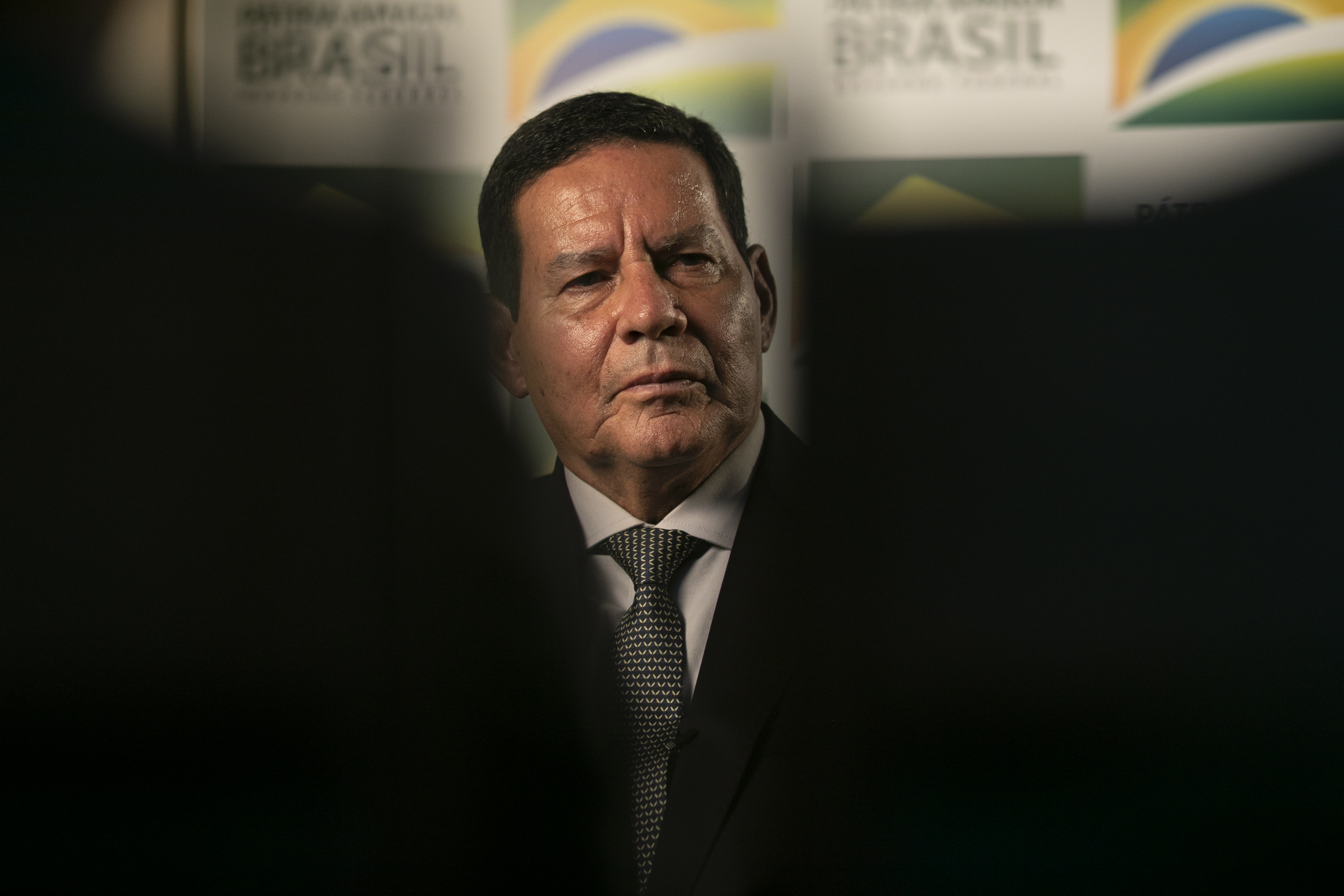 """Brazilian Vice President Hamilton Mourao gestures during an exclusive interview with AFP in his office in the annex of the Planalto Palace in Brasilia,Brazil on February 21, 2019. - Brazilian Vice President Hamilton Mourao on Thursday dismissed US threats of military intervention in Venezuela as """"premature"""" and said it """"wouldn't make sense."""" (Photo by Sergio LIMA / AFP)        (Photo credit should read SERGIO LIMA/AFP via Getty Images)"""