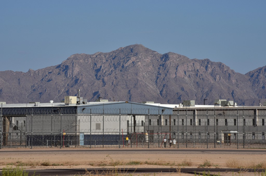 View of Eloy detention center, buildings surrounded by barbwire fences.