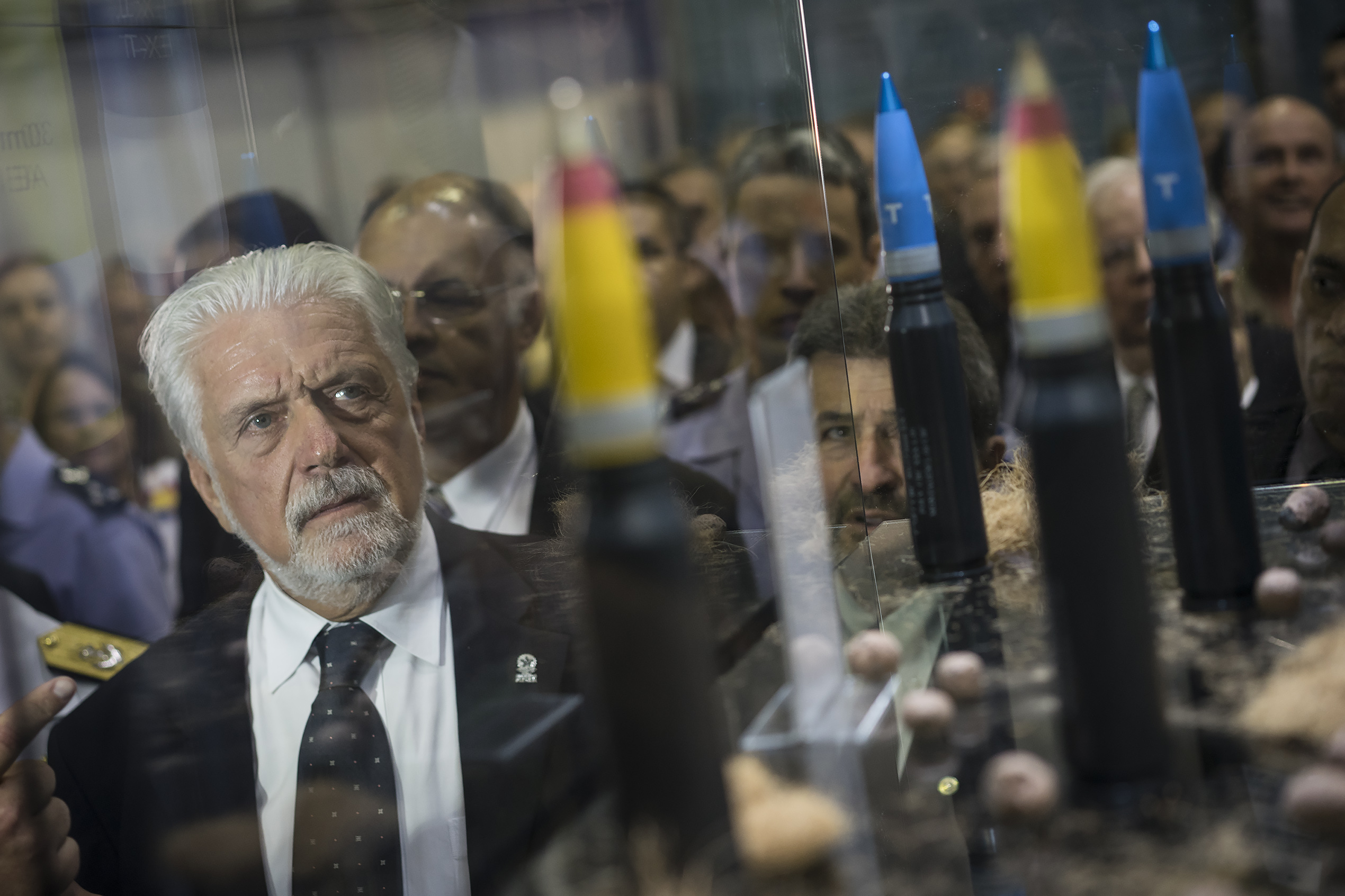 Brazil's Defense Minister Jaques Wagner looks at ammunition as he tours the LAAD Defense and Security International Exhibition in Rio de Janeiro, Brazil, Tuesday, April 14, 2015. (AP Photo/Felipe Dana)