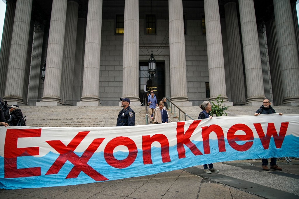 Environmental activists rally for accountability for fossil fuel companies outside of New York Supreme Court on October 22, 2019 in New York City. Tuesday is the first day of a trial where New York's attorney general is taking on ExxonMobil in a landmark case that accuses the oil corporation of misleading investors about the companys financial risks due to climate change. (Photo by Drew Angerer/Getty Images)