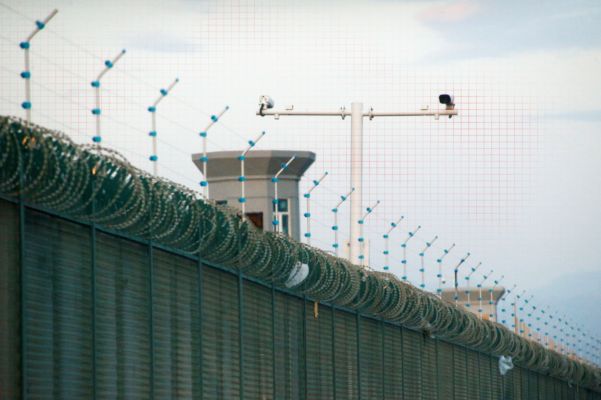 Security cameras are installed above the perimeter fence of what is officially known as a vocational skills education centre in Dabancheng, in Xinjiang Uighur Autonomous Region, China September 4, 2018. This centre, situated between regional capital Urumqi and tourist spot Turpan, is among the largest known ones.