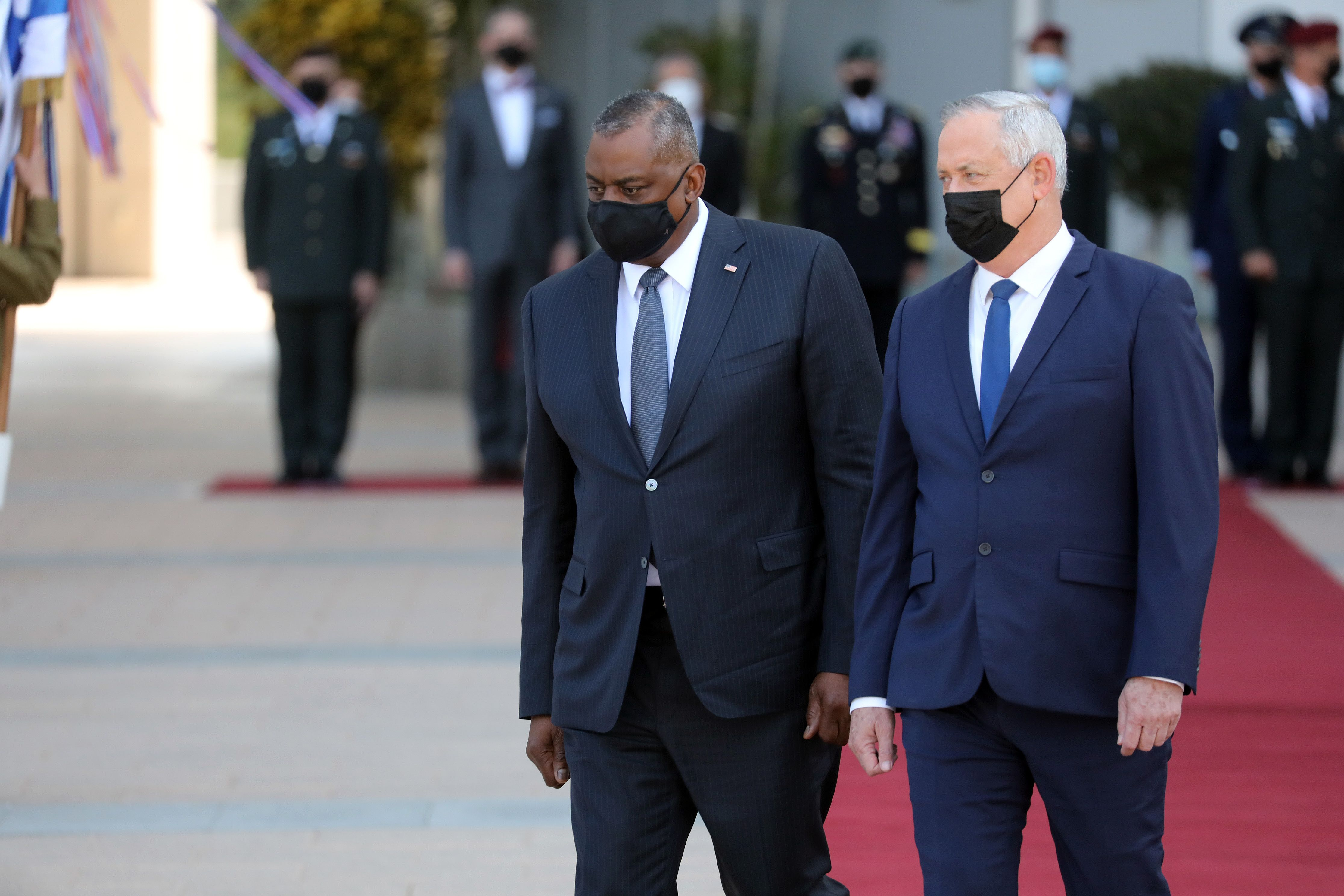 U.S. Defense Secretary Lloyd Austin (L) and Israeli Defense Minister Benny Gantz are seen at a ceremony at the Kirya military base in Tel Aviv, Israel on April 11, 2021.