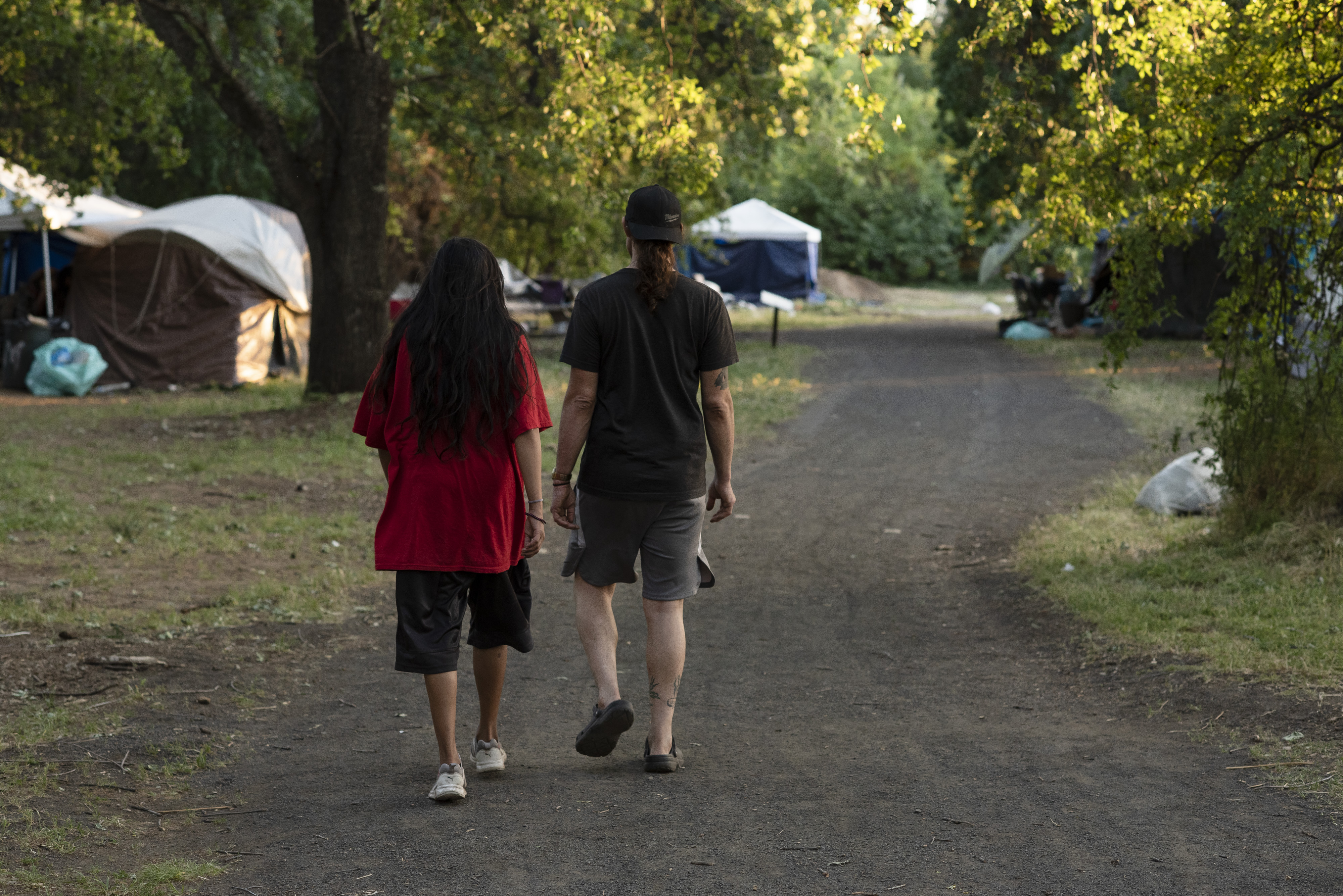 Scenes at Comanche Creek Greenway on Tuesday May 4, 2021 in Chico, Calif. Comanche Creek Greenway is the site of an unhoused community in Chico, Calif.  It's the last public park where unhoused Chico residents are currently safe from sweeps from local police. Due to an ongoing lawsuit there is a temporary restraining order preventing police from evicting the unhoused people currently living at the park.  Salgu Wissmath for The Intercept